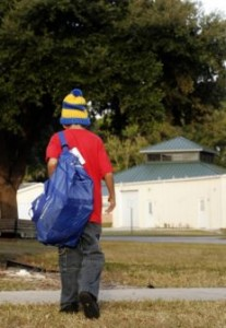 Florida foster boy walking away with My Stuff Bag