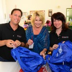 Shop2Care Founder Mark Asofsky (left), President and CEO of My Stuff Bags Foundation Janeen Holmes (center), and Shop2Care Director of Philanthropy Betsi Kassebaum.